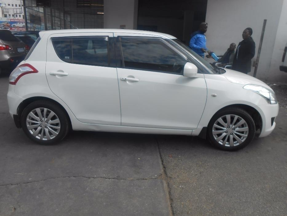 Suzuki swift 1.4 hb 2011 white colour